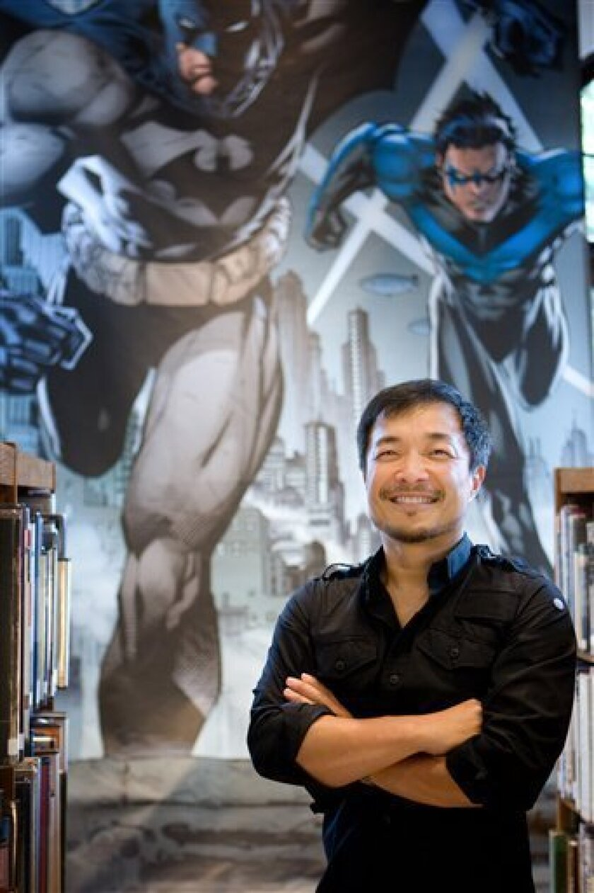 In this publicity mage released by DC Comics, DC Comics' co-publisher Jim Lee is shown. DC Comics is going back to the starting point in September, renumbering its entire lineup of DC Universe titles with No. 1 and retooling nearly all of its major characters, including Superman, Wonder Woman and B