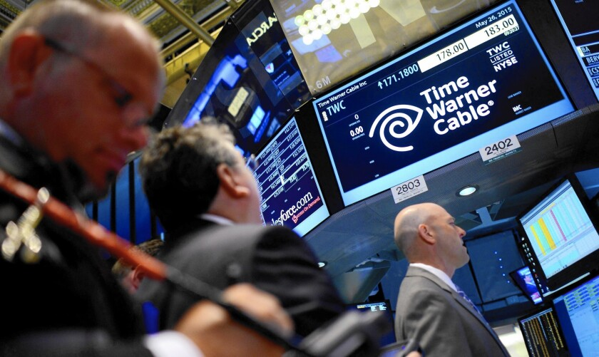 Charter's deal for Time Warner Cable values it at $195.71 a share, significantly higher than Friday's closing price of $171.18. On Tuesday, Time Warner shares gained $12.42, or 7.3%, to $183.60; Charter stock rose $4.45, or 2.5%, to $179.78. Above, the New York Stock Exchange.