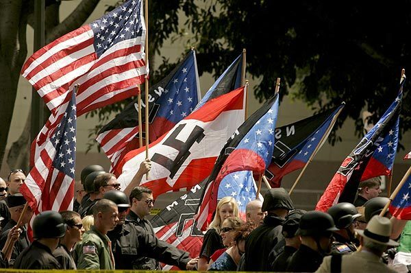 A group of about 40 National Socialist Movement members hold a rally outside Los Angeles City Hall.