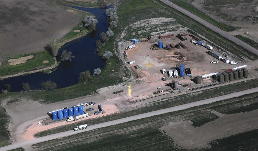 A watchdog group's review of industry and federal data from 2010 to 2014 found 351 wells in 12 states that used diesel in fracking without permits. Above, an operation in North Dakota in June.