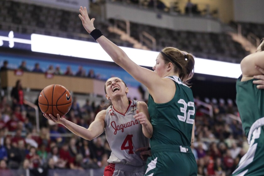 IUPUI guard Holly Hoopingarner (4) shoots under Green Bay forward Karly Murphy (32) in the first half of an NCAA college basketball game for the Horizon League women's tournament championship in Indianapolis, Tuesday, March 10, 2020. (AP Photo/Michael Conroy)