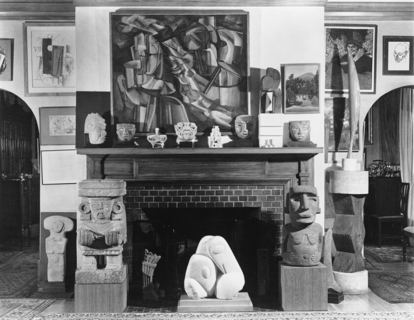 The Arensbergs' living room in 1951, with works by Picasso, Braque, Duchamp and Brancusi mixed with pre-Hispanic sculpture.