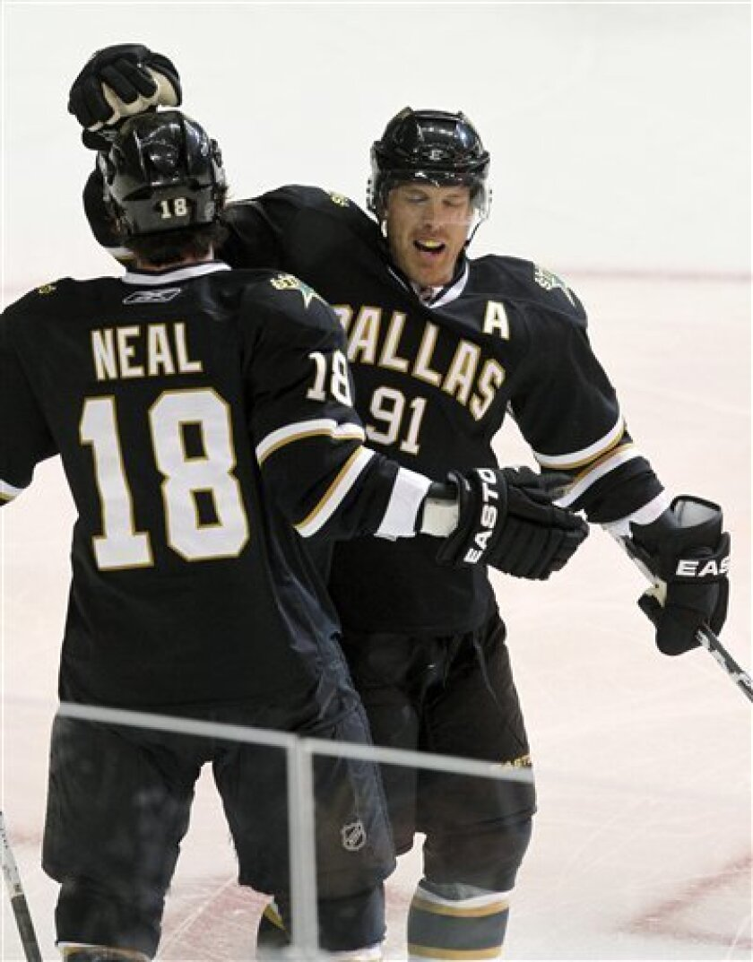 Dallas Stars center Brad Richards (91) celebrates with left wing James Neal (18) after scoring a goal on Pittsburgh Penguins goalie Brent Johnson during the first period of an NHL hockey game Wednesday, Nov. 3, 2010, in Dallas. (AP Photo/Tim Sharp)