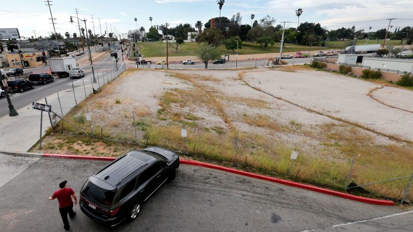 An empty lot, located at the intersection of 1st St. and Lorena St. in Boyle Heights on April 6. A nonprofit developer's plan to build housing for the homeless here has been stalled.