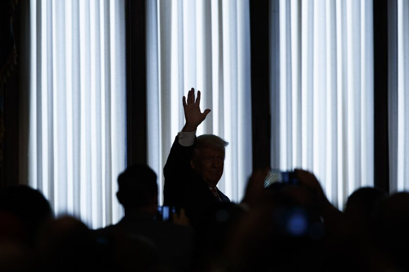 Republican presidential candidate Donald Trump waves as he walks offstage after giving a speech on national security, Wednesday, Sept. 7, 2016, at the Union League in Philadelphia. (AP Photo/Evan Vucci)