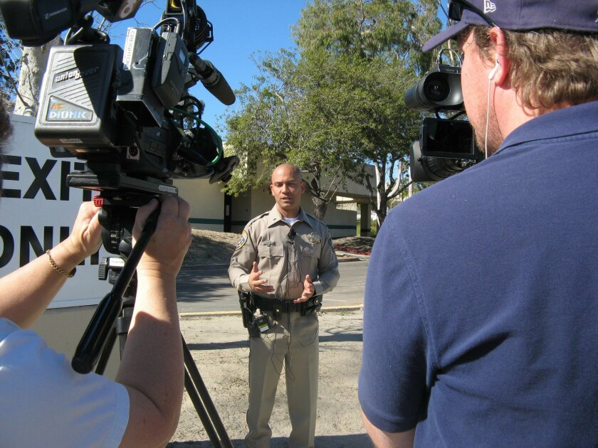 CHP Lt. Charles Leonard addresses the media after a brief bomb scare at the DMV's Oceanside office on Thursday.