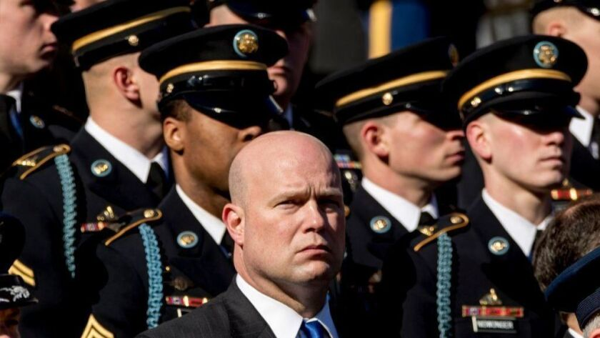Acting Atty. Gen. Matthew Whitaker attends a wreath-laying ceremony at the Tomb of the Unknown Soldier at Arlington National Cemetery on Veterans Day, Nov. 11, 2018.