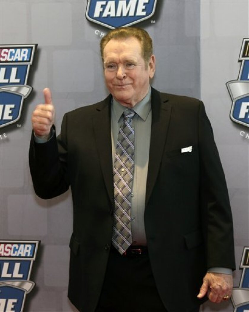 Former NASCAR driver Buddy Baker flashes a thumbs-up to the media as he arrives for the induction of his father, Buck Baker, into the NASCAR Hall of Fame, Friday Feb. 8, 2013, in Charlotte, N.C. (AP Photo/Bob Leverone)