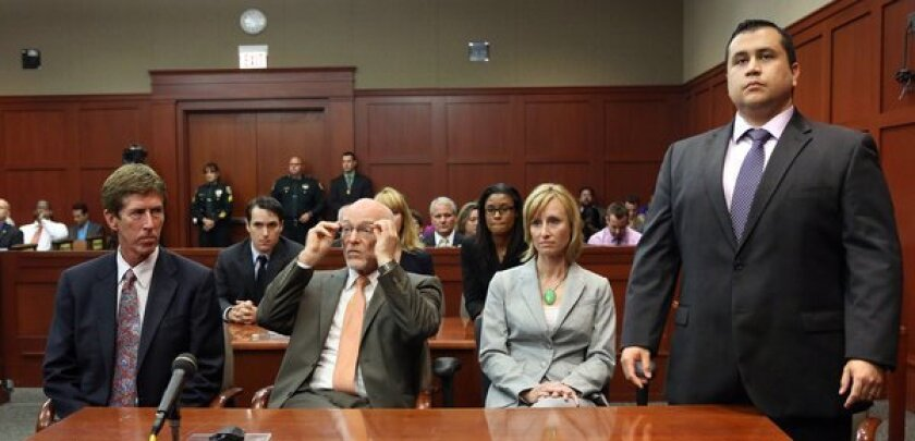 George Zimmerman stands as the jury arrives to deliver the verdict of not guilty of second-degree murder in the 2012 shooting death of Trayvon Martin.
