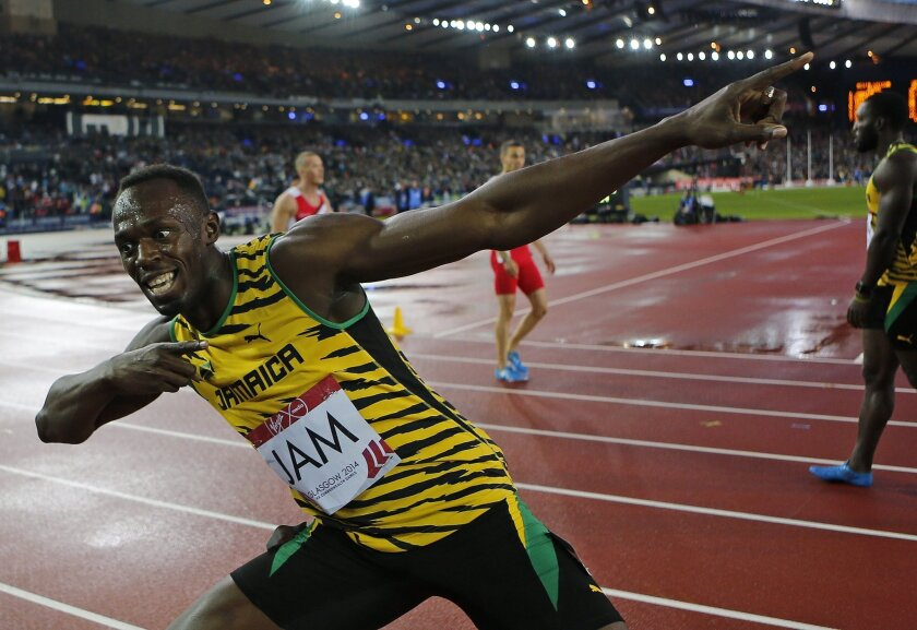 Jamaica's Usain Bolt celebrates after anchoring the Jamaican team to the gold medal in the Men's 4x100m relay at Hampden Park Stadium during the Commonwealth Games 2014 in Glasgow, Scotland, Saturday Aug. 2, 2014. (AP Photo/Frank Augstein)