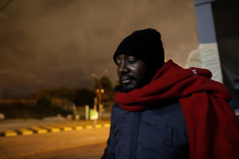 Michael Randy, 30, of Cameroon, is seeking political asylum. He camps outside Mexico's National Institute of Migration office at the Gateway International Bridge in Matamoros, Tamaulipas.