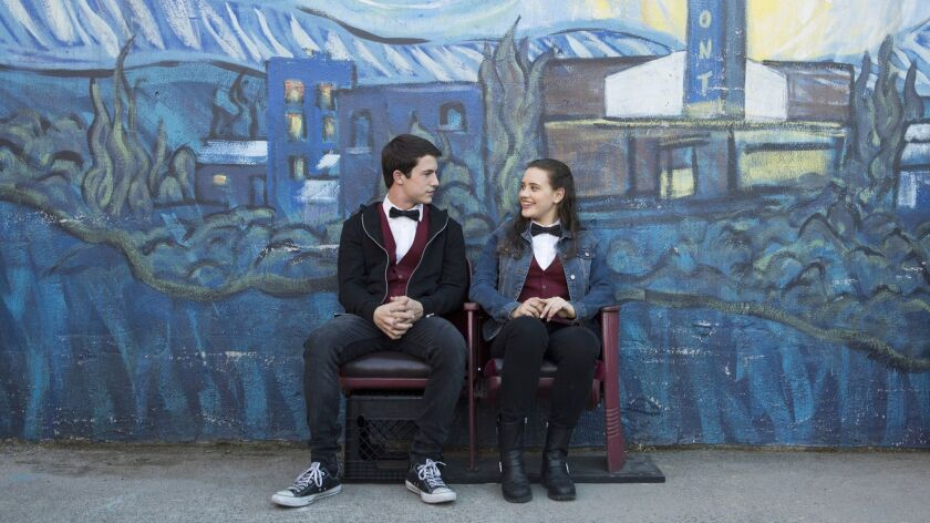 "Dylan Minnette and Katherine Langford in a scene from the Netflix series ""13 Reasons Why."""