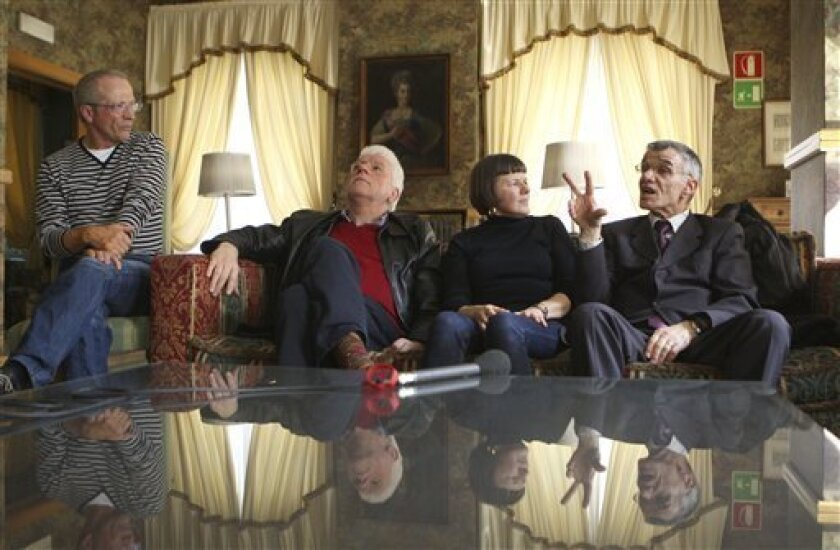 From left Gianni Bisoli, 60, Dario Laiti, 59,  interpreter Paola Lodi Rizzini  and Alessandro Vantini, 60, attend an interview with Associated Press in a hotel in Rome, Friday, March 26, 2010. Bisoli, Laiti,  Vantini, and 64 former students at Verona's Provolo Institute for the Deaf,  signed a stat