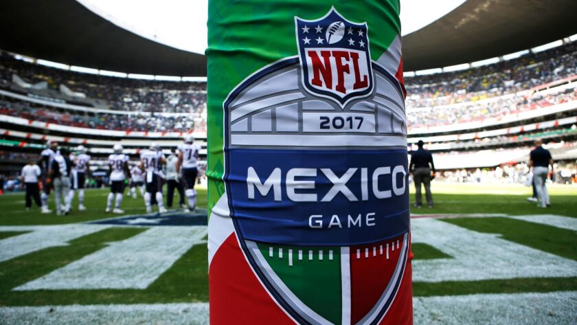 The logo for the NFL's Mexico Game is displayed on a goal post pad for a game between the Oakland Raiders and New England Patriots in Mexico City on Nov. 19, 2017.