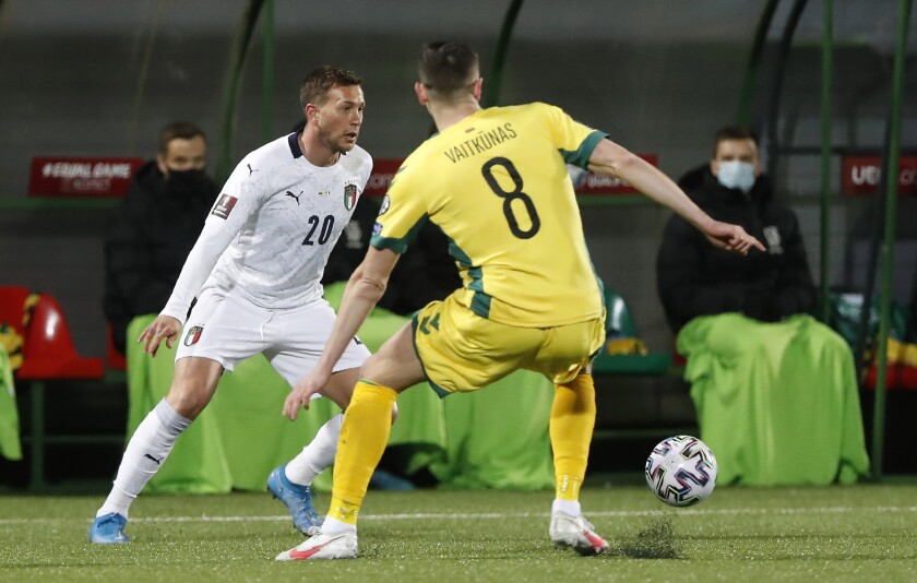 Italy's Federico Bernardeschi, left, challenges for the ball with Lithuania's Egidijus Vaitkunas during the World Cup 2022 Group C qualifying soccer match between Lithuania and Italy at LFF stadium in Vilnius, Wednesday, March 31, 2021. (AP Photo/Mindaugas Kulbis)