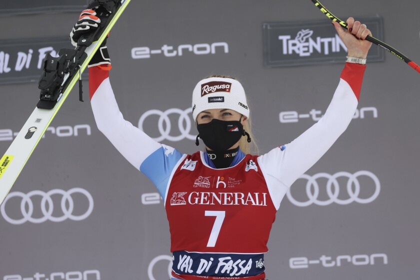 The winner, Switzerland's Lara Gut-Behrami, celebrates after an alpine ski, women's World Cup downhill, in Val di Fassa, Italy, Saturday, Feb. 27, 2021. (AP Photo/Alessandro Trovati)