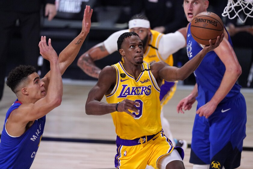 Lakers guard Rajon Rondo drives down the lane for a layup against the Nuggets during a Game 1 win on Sept. 18, 2020.
