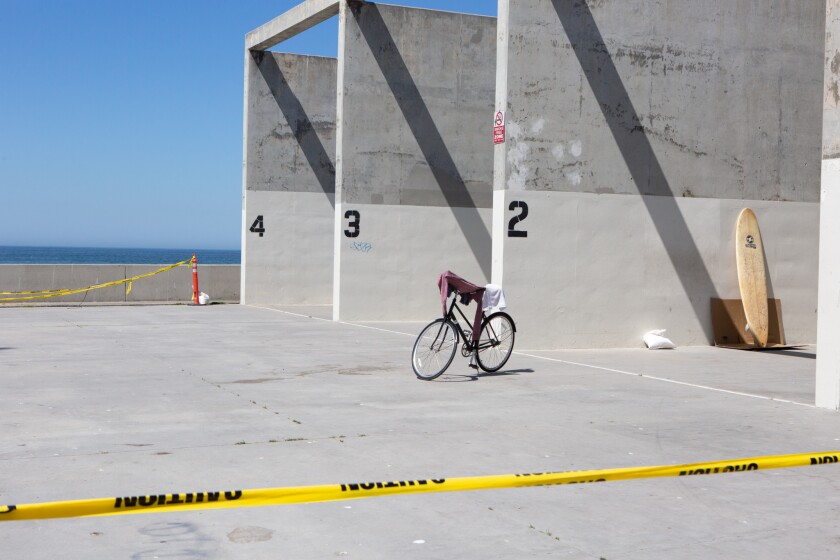 Handball courts along the Venice Beach boardwalk were deserted Friday.