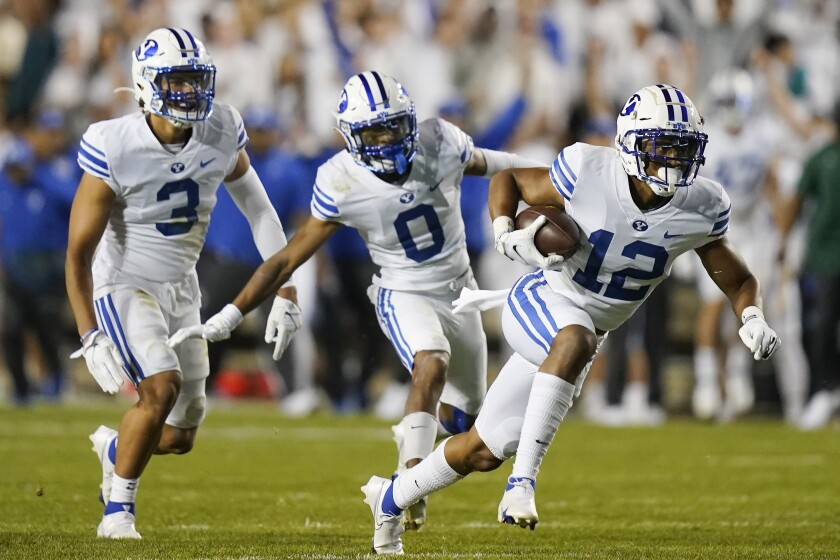 BYU defensive back Malik Moore (12) and teammates celebrate his interception against Arizona State during the first half of an NCAA college football game Saturday, Sept. 18, 2021, in Provo, Utah. (AP Photo/Rick Bowmer)