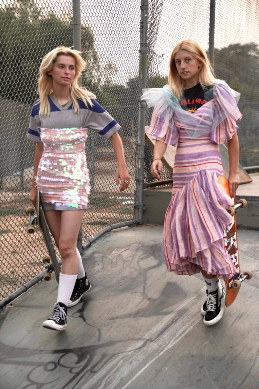 Imitation of Christ looks on models with skateboards