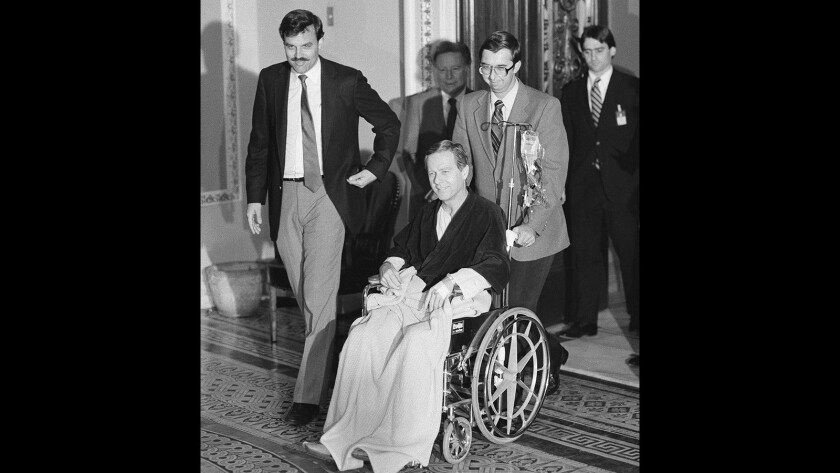 Then-Sen. Pete Wilson, R-Calif., is wheeled out of the Senate Chamber in 1985 after casting a key budget vote. Just over 24 hours earlier, Wilson had surgery for a ruptured appendix. Then-Vice President George Bush cast the tie-breaking vote on the controversial measure.