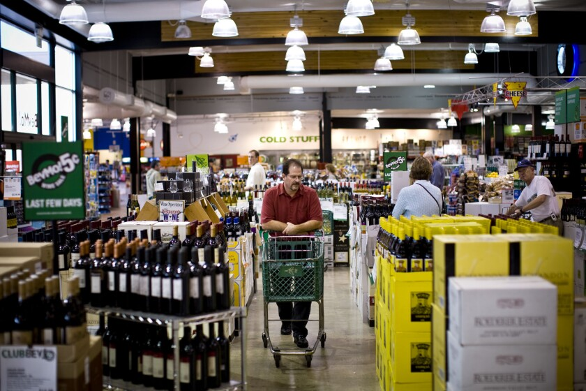 Customers browse the wine section of a BevMo store in Walnut Creek, Calif.