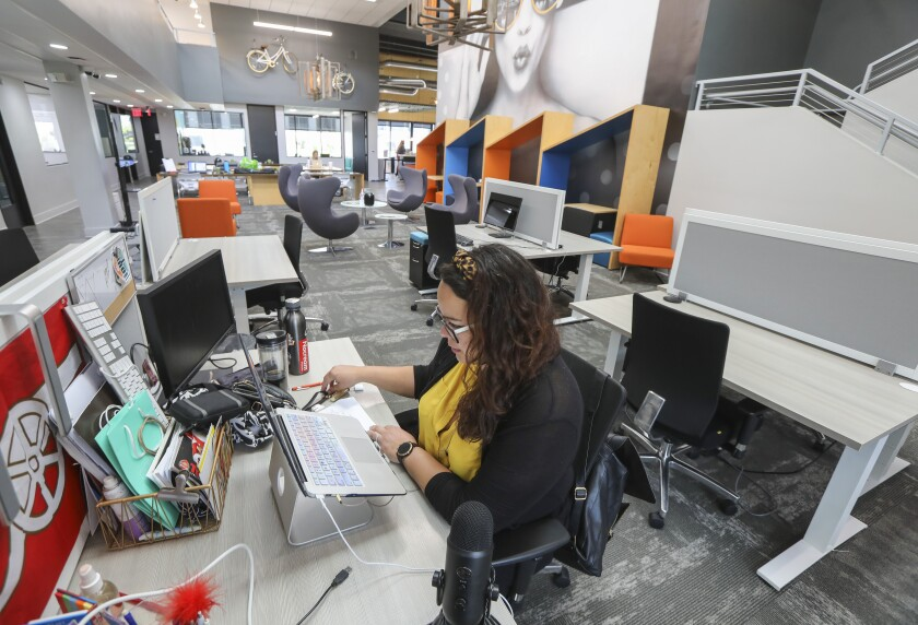 Marketing consultant Marisa Cali sits at her socially-distanced desk at coworking space Downtown Works on May 19, 2020.