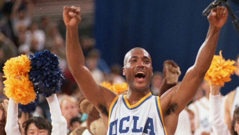 UCLA's Ed O'Bannon celebrates after his team won the NCAA championship in Seattle on April 3, 1995. O'Bannon later sued the NCAA over its use of former student athletes' images without compensation, winning a partial victory.