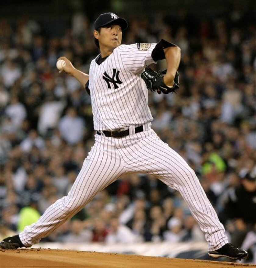 New York Yankees Chien Ming Wang of Taiwan, winds up in the first inning of the Yankees opening day baseball game against the Toronto Blue Jays at Yankee Stadium in New York, Tuesday, April 1, 2008. (AP Photo/Kathy Willens)