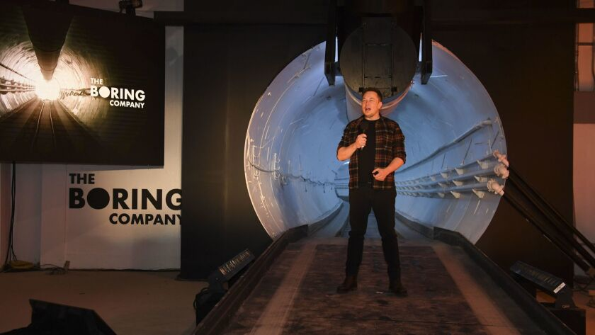 Elon Musk speaks during an unveiling event for the Boring Co. test tunnel in Hawthorne on Dec. 18.