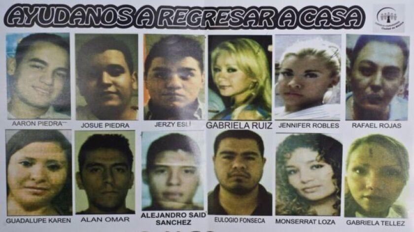 Cartel con fotos de los jóvenes desaparecidos en el Bar Heaven, en 2013.