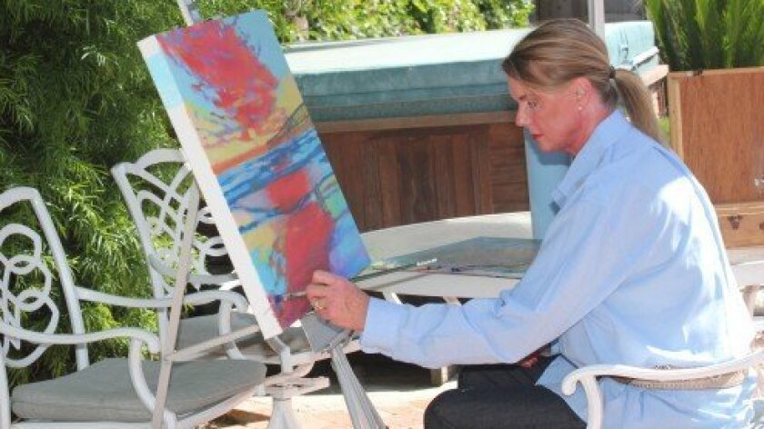 Anne Waddell works plein air on a newly commissioned piece at her Bird rock home. Pat Sherman