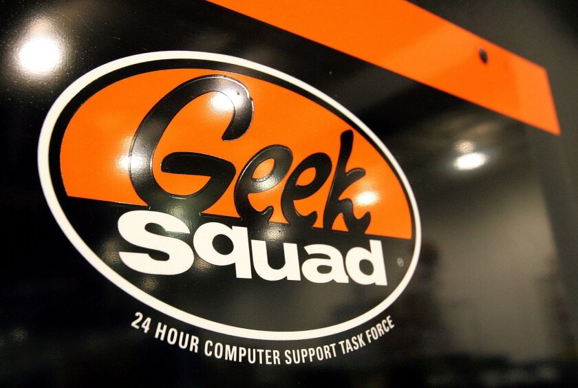 "A ""Geek Squad"" sign hangs on a door at its computer repair facility in a Best Buy store in Niles, Ill."