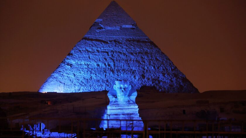 FILE - In this Saturday, Oct. 24, 2015, file photo, the Sphinx and the historical site of the Giza P