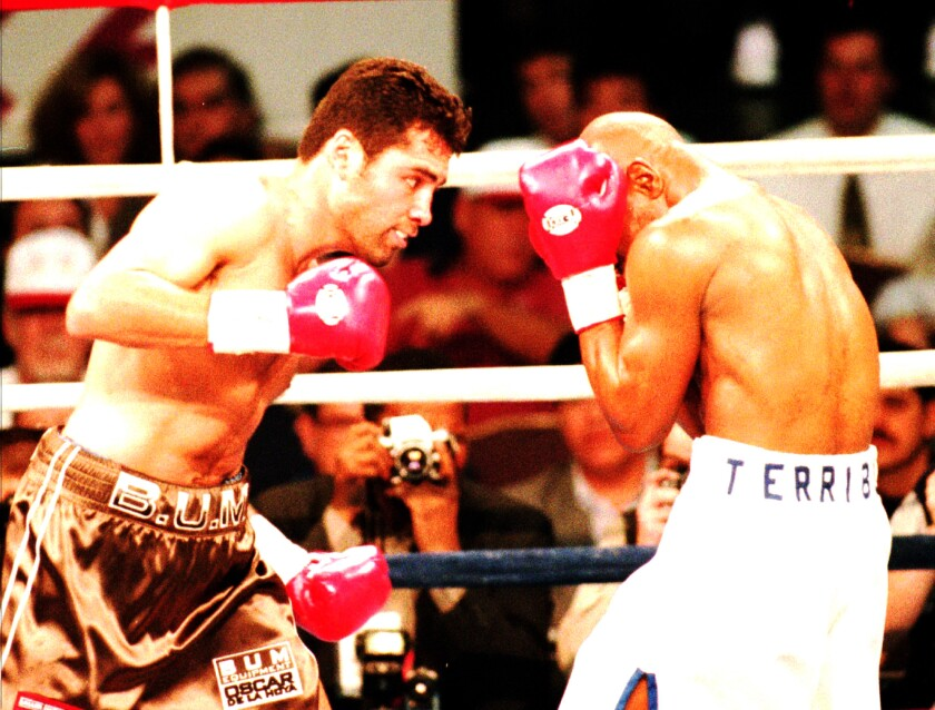 WBO lightweight champion Oscar De La Hoya, left, attacks Darryl Tyson in the second round of their junior welterweight title elimination bout Friday, Feb. 9, 1996, in Las Vegas. De La Hoya won the bout by knock out in the second round.