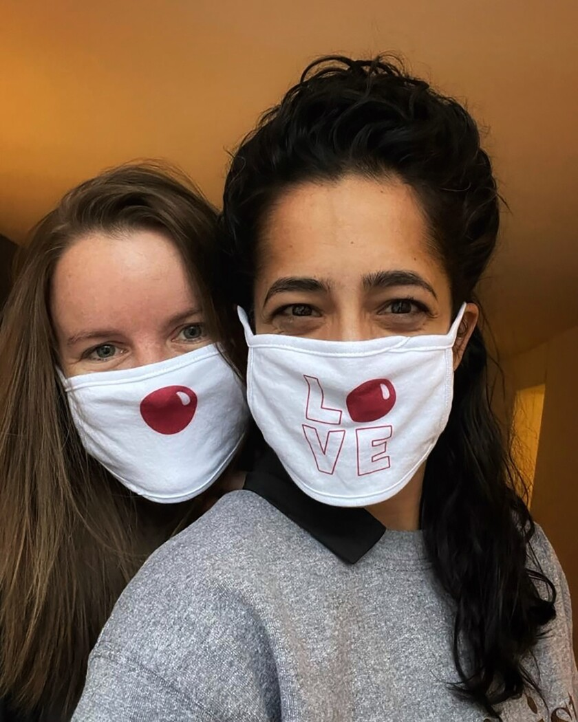 This undated photo provided by Comic Relief's Red Nose Day shows the special Red Nose Day masks that Walgreens employees will wear for the 2021 fundraising campaign. (Red Nose Day via AP)