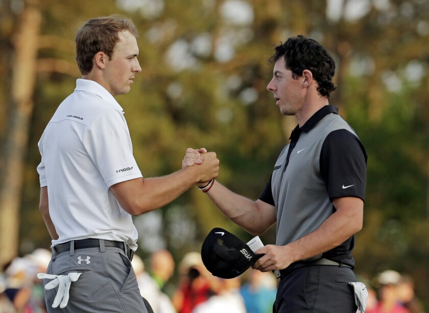 Jordan Spieth and Rory McIlroy shake hands after the second round of the Masters at Augusta National on April 11, 2014.