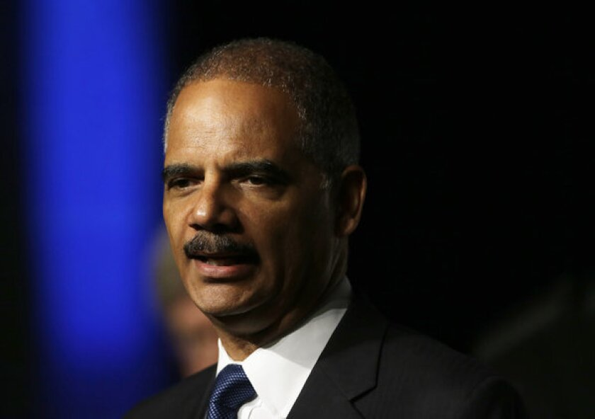 Atty. Gen. Eric Holder plans to challenge a new voter ID law in Texas, saying it is discriminatory.
