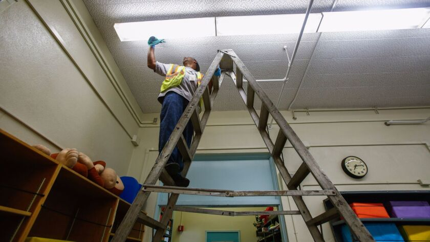 Before Los Angeles schools open for the fall, rooms at 49th Street Elementary and elsewhere must be cleaned from top to bottom, with the help of L.A. Unified Building and Grounds worker Johnny Bowie and others.