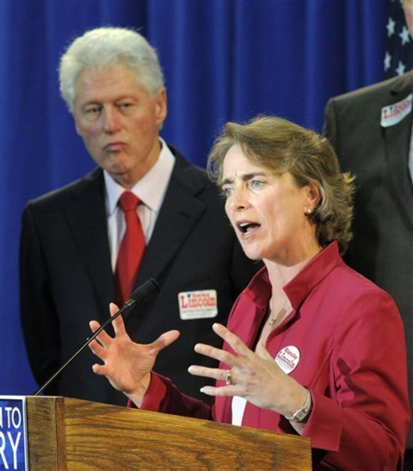 FILE - In this May 28, 2010 file photo, former President Bill Clinton looks on as Sen. Blanche Lincoln, D-Ark. in Little Rock, Ark. The days of Barack Obama traipsing the country in freewheeling campaign mode _ with sky-high popularity serving as an asset to all Democratic candidates _ are long over. And the White House knows it. (AP Photo/Brian Chilson, File)