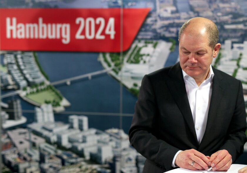 Hamburg First Mayor Olaf Scholz reacts after the referendum on Hamburg's Olympic bid is rejected.