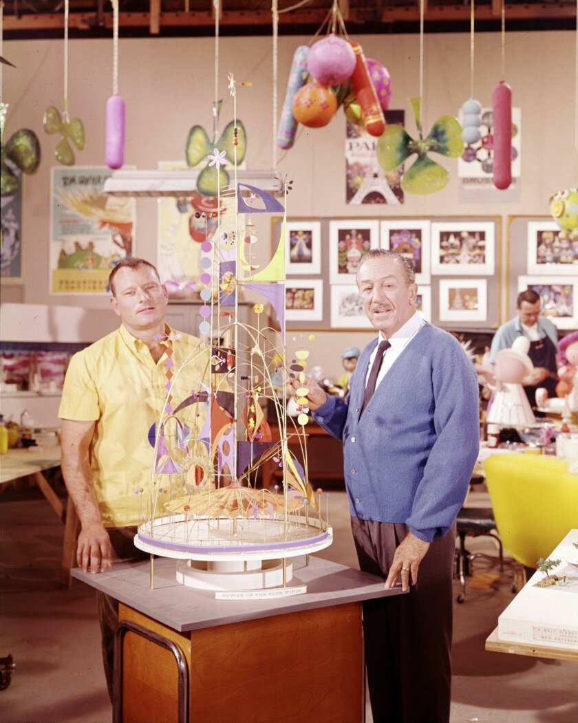 "Walt Disney, right, and Rolly Crump with a model of Crump's Tower of the Four Winds monument for the ""small world"" ride at the 1964 New York World's Fair."