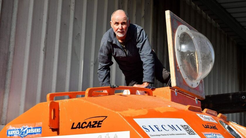 Jean-Jacques Savin works on his barrel ship at the shipyard in Ares, France, on Nov. 15.