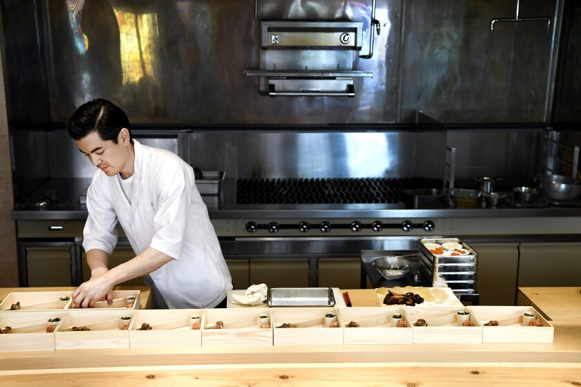 Brandon Go, chef and owner of Hayato, prepares his famous bento boxes.