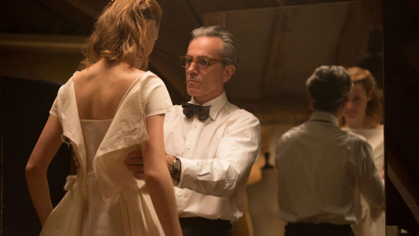 In this image released by Focus Features, Vicky Krieps, left, and Daniel Day-Lewis appear in a scene