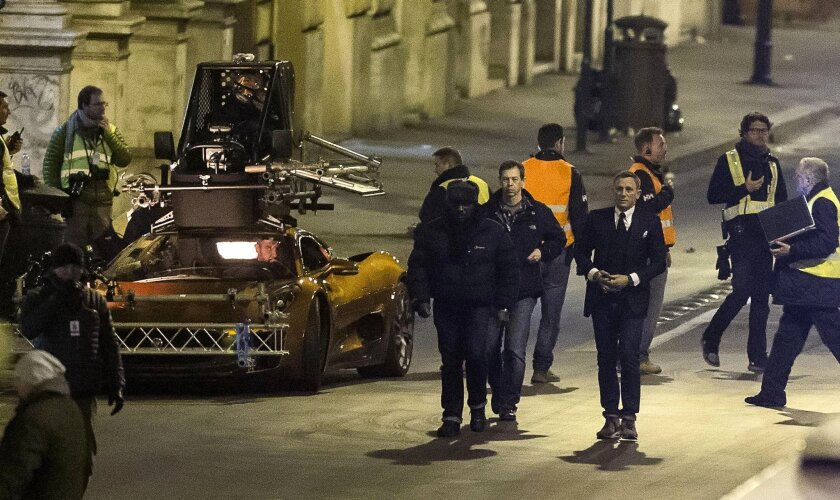 """Actor Daniel Craig, center right, during the shooting of """"Spectre"""" in Rome in February."""