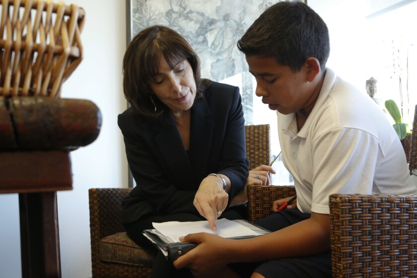 William Morris Endeavor talent agent Nancy Josephson helps Whaley Middle School student Edgar Ruelas with his math homework in her office at Beverly Hills-based WME in October. Josephson has mentored Ruelas for several years.