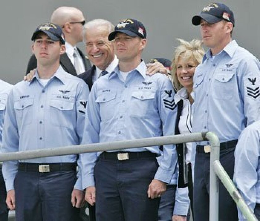 Vice president Joe Biden used some of his time yesterday on the aircraft carrier Ronald Reagan to outline several measures in the economic stimulus package, including construction projects on military bases. (John Gibbins / Union-Tribune)
