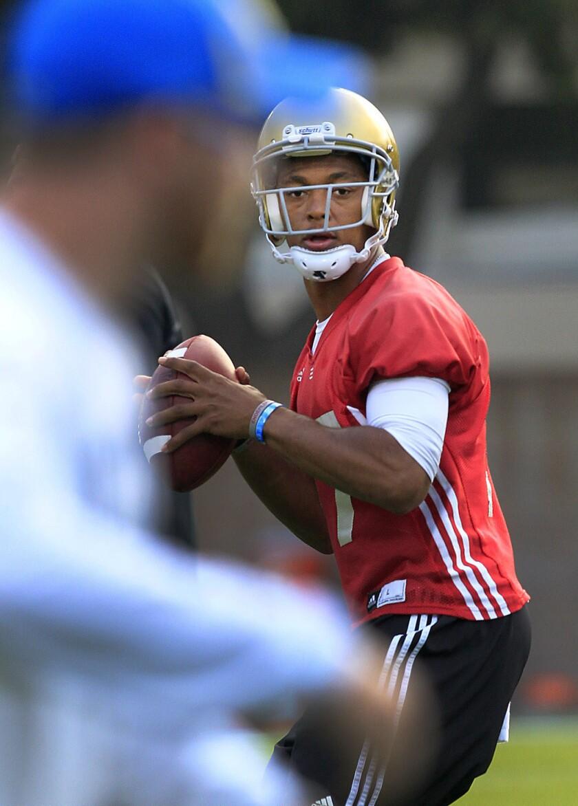UCLA starting quarterback Brett Hundley practices on the field at UCLA.