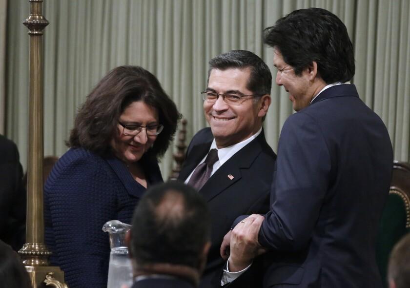 Xavier Becerra, Carolina Reyes and Sen. Kevin De Leon
